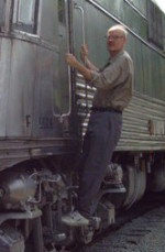 John Byers hanging on a train